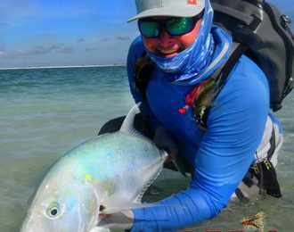 eric dalzell with reds fly shop trevally caught fly fishing on a popper