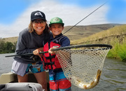 woman and kid fly fishing